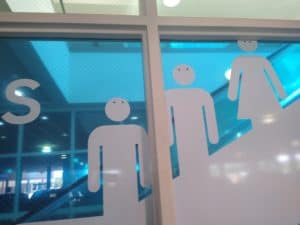 Outline figures on escalator.... now with googly eyes.